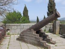 Kanone auf der Stadtwand Stockfoto