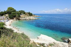 Turkuaz water of Kanoni Beach, Kassiopi Village, Corfu Island, Greece, Europe royalty free stock photo