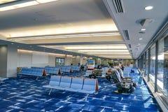 Kansai region, Osaka, Japan - 4 Mar 2018: Passengers sit and wait the plane in Kansai International Airport on 4 Mar 2018 in the royalty free stock photos