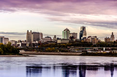 Kansas City Missouri city scape. A beautiful cityscape view of Kansas City from across the river showing the horizon at dusk, sundown with reflection of city in stock images