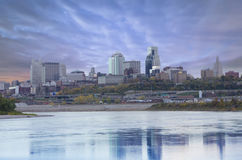 Kansas City Missouri city scape. A beautiful cityscape view of Kansas City from across the river showing the horizon at dusk, sundown with reflection of city in stock photos