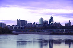 Kansas City Missouri city scape. A beautiful cityscape view of Kansas City from across the river showing the horizon at dusk, sundown with reflection of city in royalty free stock photos