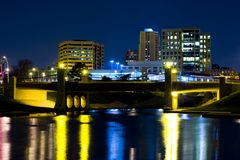 Kansas City Plaza Urban Reflections. Lights from bridge and buildings reflecting in the water at night... location Kansas City off the plaza Royalty Free Stock Photography