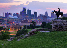 Kansas City Skyline at Dawn. View of Kansas City, Missouri skyline at dawn during golden light from the Kansas City Scout Memorial with all registered trademarks Royalty Free Stock Photography