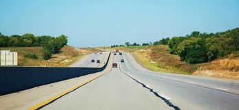 Kansas interstate road  wide perfect travel. There is part of  USA interstate road , which is  in Kansas state , for travelers the condition of  roads in Royalty Free Stock Images