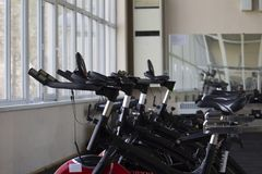 Kant, Kyrgyzstan- March 01 , 2019 : Row of training exercise bikes detail. Healthy lifestyle concept stock photo
