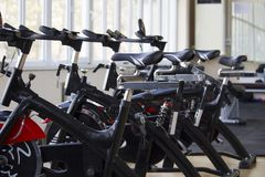Kant, Kyrgyzstan- March 01 , 2019 : Row of training exercise bikes detail. Healthy lifestyle concept royalty free stock images