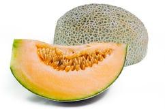 Kantalup, Charentais melon z połówką lub ziarna na bielu zdjęcie stock