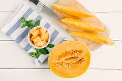 kantalupa melon na drewnianym stole Fotografia Stock