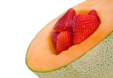 Kantalupe und Erdbeeren stockfotos