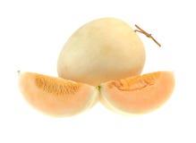 Kantalupenmelone lokalisiert auf weißem Hintergrund Stockfotos