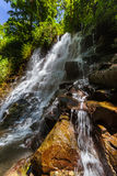 Kanto Lampo vattenfall på den Bali ön Indonesien Royaltyfria Bilder