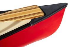 Kanubogen mit einem Paddel Stockfotos