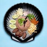 Kao Klook Ga-pi & x28;Rice Mixed with Shrimp paste& x29; on blue wood.  Stock Image