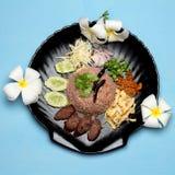 Kao Klook Ga-pi & x28;Rice Mixed with Shrimp paste& x29; on blue wood.  Stock Photo