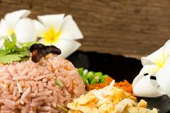 Kao Klook Ga-pi (Rice Mixed with Shrimp paste) on old wood.  Stock Photos
