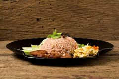 Kao Klook Ga-pi (Rice Mixed with Shrimp paste) on old wood.  Royalty Free Stock Photo