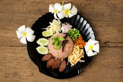 Kao Klook Ga-pi (Rice Mixed with Shrimp paste) on old wood.  Stock Images