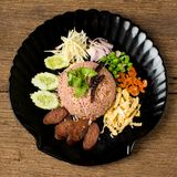 Kao Klook Ga-pi (Rice Mixed with Shrimp paste) on old wood.  Royalty Free Stock Image