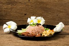 Kao Klook Ga-pi (Rice Mixed with Shrimp paste) on old wood.  Royalty Free Stock Photography