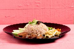 Kao Klook Ga-pi (Rice Mixed with Shrimp paste) on pink wood.  Royalty Free Stock Image