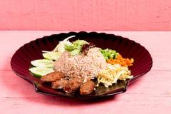 Kao Klook Ga-pi (Rice Mixed with Shrimp paste) on pink wood.  Royalty Free Stock Photos