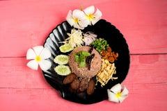Kao Klook Ga-pi & x28;Rice Mixed with Shrimp paste& x29; on pink wood.  Stock Photo
