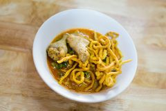 Kao Soi yellow curry noodles. Fresh prepared asian hot Kao Soi yellow curry noodles served with chicken wings. Traditional Chiang Mai thai cuisine made of fresh Stock Image