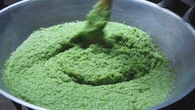 Kao Tom Mud. Stiring Green Sweet Sticky Rice In Process Of Making Thai Sweet, `Kao Tom Mud stock video