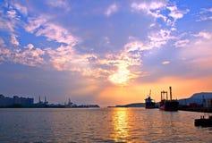 Kaohsiung hamn på solnedgången Royaltyfri Foto