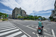 Kaohsiung Street View. A motorcycle is at left turn waiting zone of the crossing area in the downtown of kaohsiung city, taiwan Royalty Free Stock Image