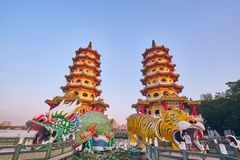 Eople come to merit at Cih Ji Dragon and Tiger Pagodas on lotus pond in sunset time. Kaohsiung, Taiwan - December 3, 2018: People come to merit at Cih Ji Dragon stock images