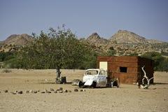 Kaokoland rural art. Rural arcitectural art with old car and house in Kaokoland, Namibia Stock Photos