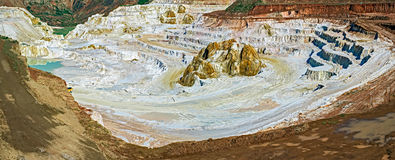 Kaolin career. With white plaster material and lake Stock Image