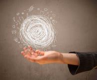 Kaosbegrepp i handen av en kvinna Fotografering för Bildbyråer