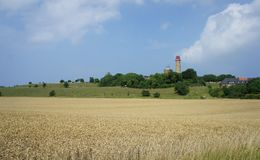 Kap Arkona lighthouse in Rugen island, Germany. In meadows and fields Royalty Free Stock Photography