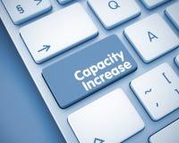 Kapacitetsförhöjning - text på tangentbordknappen 3d Arkivfoto