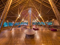 Kapal Bambu Restaurant in Ecolodge Bukit Lawang, Indonesia. Kapal Bambu second floor for rest, using hammock, laying in a sofa. The restaurant is constructed Royalty Free Stock Image