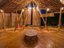 Kapal Bambu Restaurant in Ecolodge Bukit Lawang, Indonesia. Kapal Bambu second floor for rest, using hammock, laying in a sofa. The restaurant is constructed Stock Photos