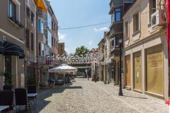 Street and houses in district Kapana, city of Plovdiv, Bulgaria. KAPANA, PLOVDIV, BULGARIA - JULY 5, 2018: Street and houses in district Kapana, city of Plovdiv royalty free stock image