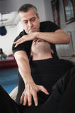 Kapap instructor demonstrates choke techniques Royalty Free Stock Photos