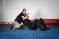 Kapap instructor demonstrates choke techniques Stock Photography
