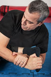 Kapap instructor demonstrates ground fighting techniques Royalty Free Stock Photography