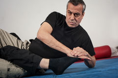 Kapap instructor demonstrates ground fighting techniques Stock Images