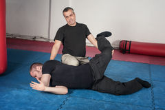 Kapap instructor demonstrates ground fighting techniques Stock Photos