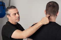 Kapap instructor shows the critical points. Pressure points figh. Kapap instructor shows the critical and highly sensitive points on the human body. Pressure royalty free stock photos