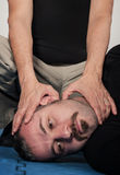 Kapap instructor shows the critical points. Pressure points figh Royalty Free Stock Photo