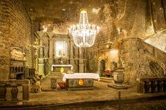 Kapell i den huvudsakliga korridoren i Wieliczkaen arkivbilder