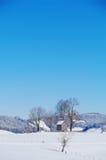Kapell i vinterlandskap Fotografering för Bildbyråer