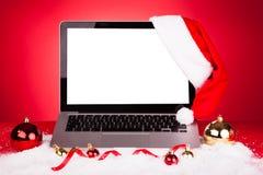 kapeluszowy laptop Santa Obrazy Stock